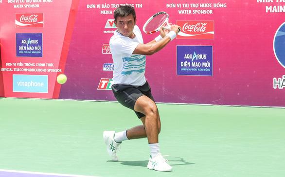 Lý Hoàng Nam vào tứ kết Giải ITF World Tennis Tour M25 - Ảnh 1.