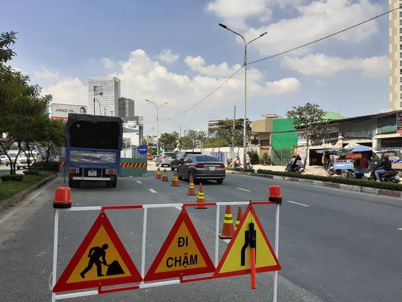 TP.HCM cấm ôtô rẽ trái vào đường Nguyễn Hữu Cảnh để bớt áp lực giao thông - Ảnh 1.