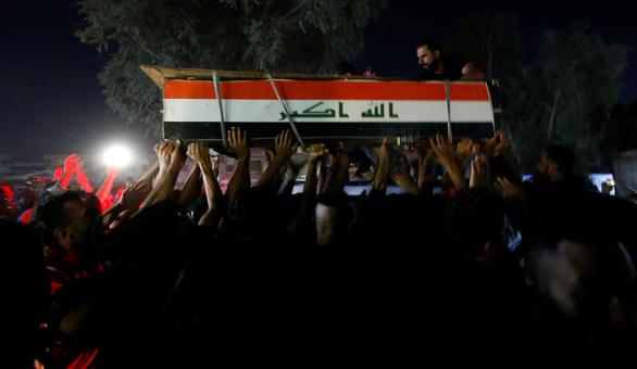 Biểu tình khắp nơi, hơn trăm người chết, Iraq hứa cải tổ - Ảnh 3.