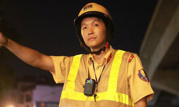 Bộ Công an đề xuất người dân được ghi hình giám sát cảnh sát giao thông - Ảnh 1.