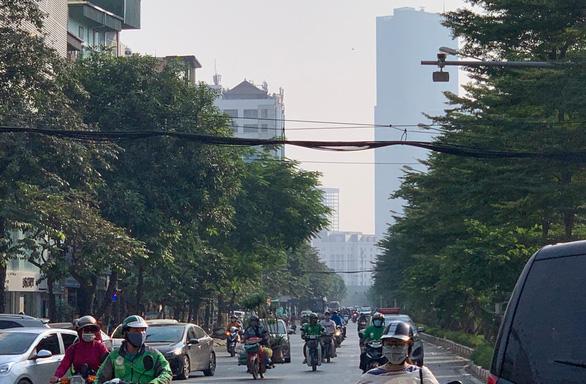 Miền Bắc ô nhiễm không khí nghiêm trọng, khuyến cáo hạn chế ra đường - Ảnh 1.