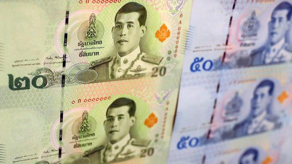 Đồng baht tăng kỷ lục, du lịch, xuất khẩu Thái Lan bị ảnh hưởng nặng - Ảnh 1.