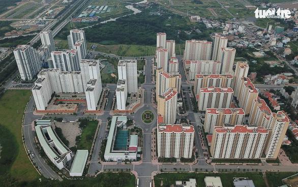 TP.HCM giao quận huyện quản lý hơn 3.400 căn hộ, nền đất tái định cư - Ảnh 1.