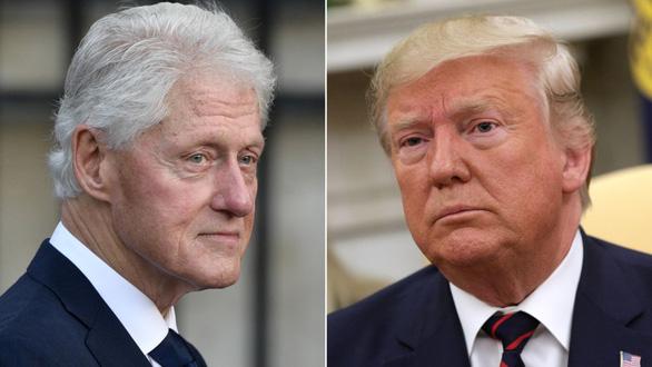 Clinton khuyên Trump: Đừng bận tâm điều tra luận tội, cứ làm việc của mình! - Ảnh 1.