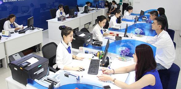 Từ 19-11, các ngân hàng phải giảm 0,5%/năm lãi suất cho vay - Ảnh 1.