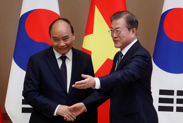 Tổng thống Hàn Quốc nhờ Việt Nam thúc đẩy hòa bình trên bán đảo Triều Tiên - Ảnh 1.