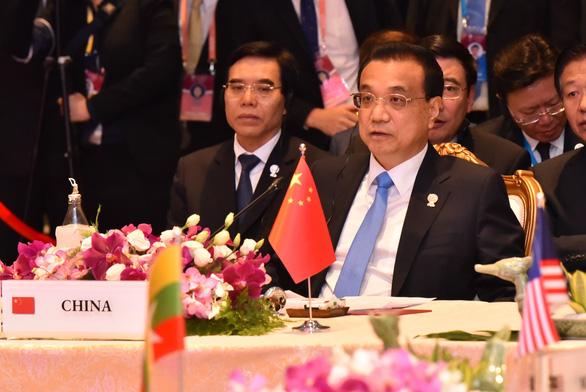 Trung Quốc lại hối thúc ASEAN hoàn tất COC trong 3 năm - Ảnh 1.