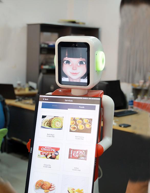 Nhóm nghiên cứu AI của ĐH Duy Tân chế tạo robot phục vụ - Ảnh 2.