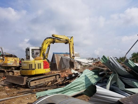 Cưỡng chế thu hồi hơn 3.300m2 đất công tại quận 9 - Ảnh 1.
