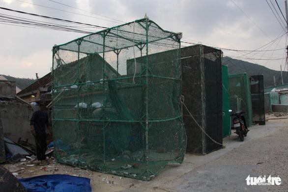 Hàng trăm người dân làng biển Nhơn Hải hối hả lo chống bão - Ảnh 6.