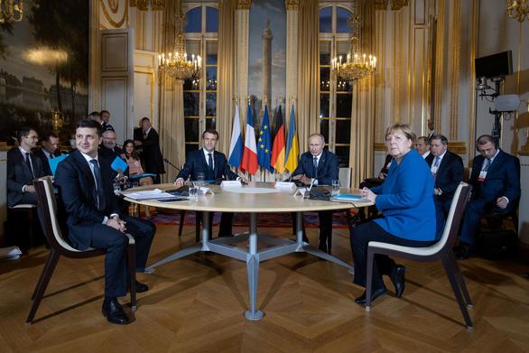 Lần đầu tiên ông Putin gặp tân tổng thống Ukraine - Ảnh 1.