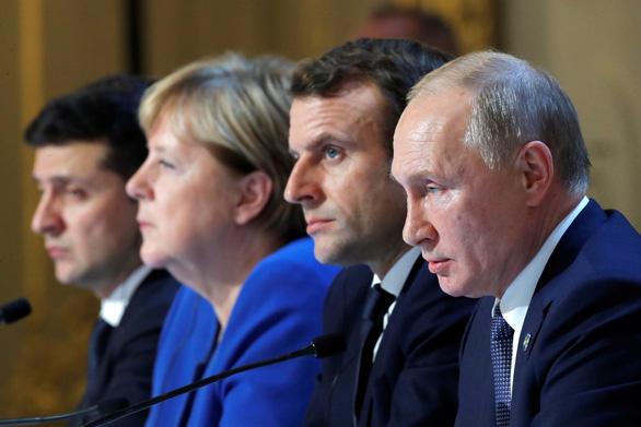 Nga, Ukraine nhất trí đình chiến đầy đủ và toàn diện ở đông Ukraine - Ảnh 1.