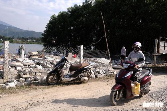 Đà Nẵng phá dỡ nhiều công trình tạm bợ trái phép nghi đón đền bù giải tỏa - Ảnh 3.