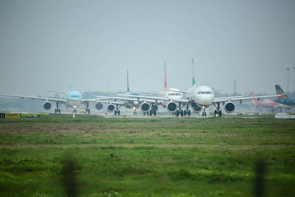 Hàng không Việt Nam dừng bay đến Vũ Hán - Ảnh 1.