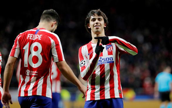 Atletico Madrid đáp 'tàu muộn' vào vòng 16 đội Champions League - Ảnh 1.