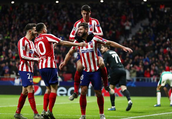 Atletico Madrid đáp 'tàu muộn' vào vòng 16 đội Champions League - Ảnh 2.