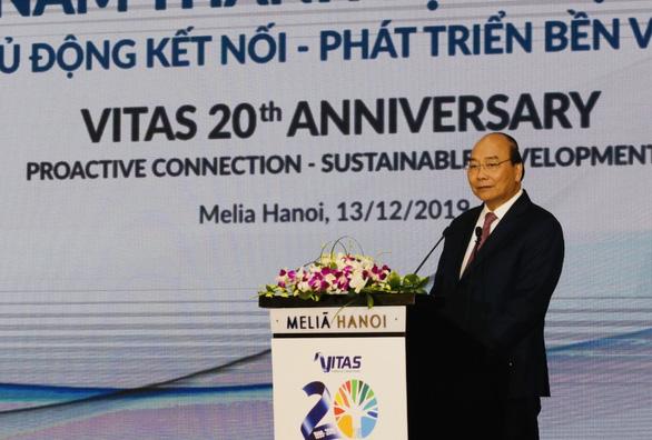 Thủ tướng: Phấn đấu 110 tỉ USD năm 2030, dệt may cần quyết tâm như 2 đội bóng - Ảnh 1.