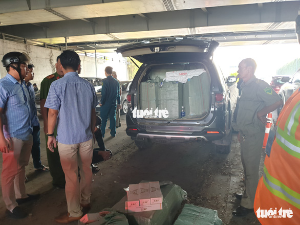 Xe chở thuốc lá lậu tai nạn ở hầm Thủ Thiêm: Trên xe có nhiều biển số giả - Ảnh 5.