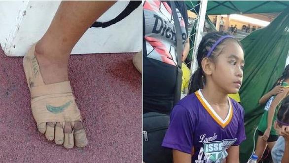 Nữ sinh giành 3 huy chương vàng điền kinh dù không có giày mang - Ảnh 1.
