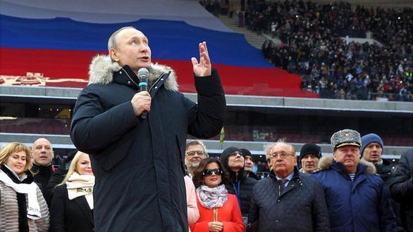 Nhìn lại 20 năm lãnh đạo của ông Putin qua 20 bức ảnh - Ảnh 2.