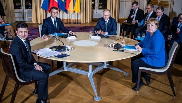 Nhìn lại 20 năm lãnh đạo của ông Putin qua 20 bức ảnh - Ảnh 14.