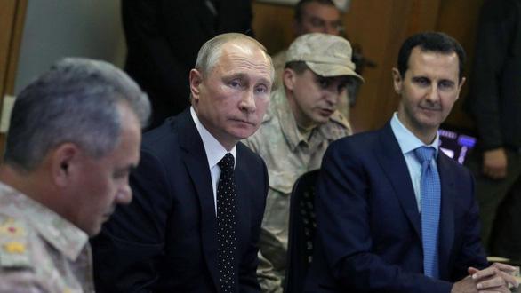 Nhìn lại 20 năm lãnh đạo của ông Putin qua 20 bức ảnh - Ảnh 15.