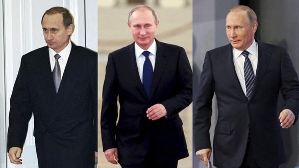 Nhìn lại 20 năm lãnh đạo của ông Putin qua 20 bức ảnh - Ảnh 1.