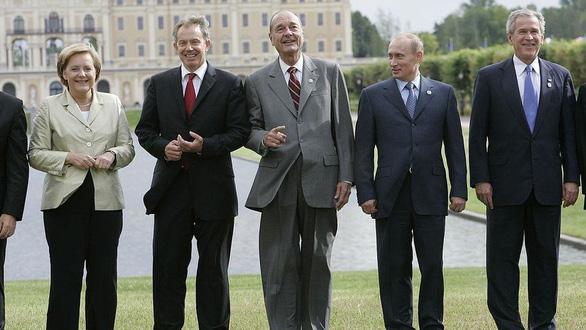 Nhìn lại 20 năm lãnh đạo của ông Putin qua 20 bức ảnh - Ảnh 10.