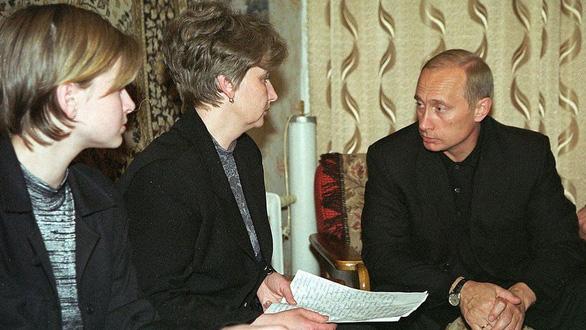 Nhìn lại 20 năm lãnh đạo của ông Putin qua 20 bức ảnh - Ảnh 5.