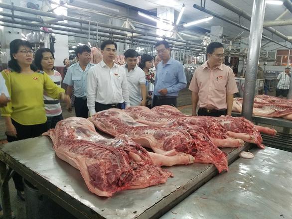 TP.HCM cam kết đủ 100% thịt heo tết - Ảnh 1.