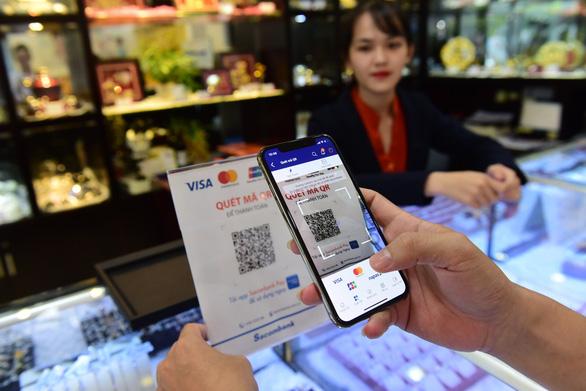 Việt Nam đứng đầu ASEAN về thu hút vốn đầu tư trong fintech - Ảnh 1.