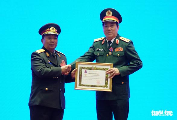 Trao huân chương của Việt Nam, Lào, Campuchia cho các cá nhân, tập thể - Ảnh 4.