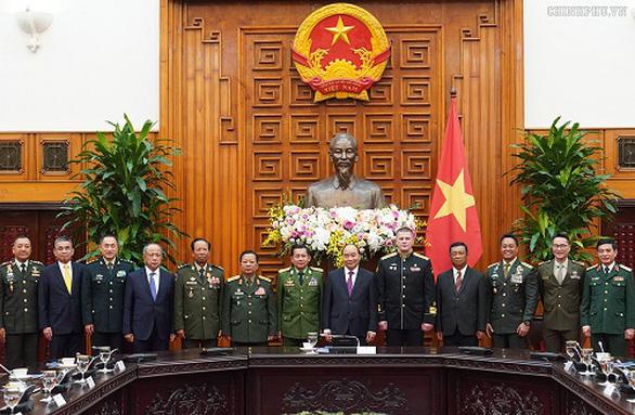 Thủ tướng tiếp lãnh đạo quân đội các nước dự kỷ niệm 75 năm thành lập Quân đội nhân dân - Ảnh 1.
