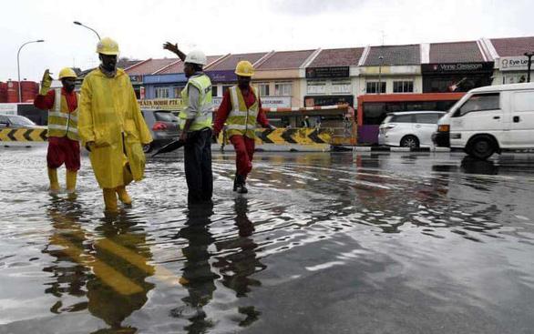 Singapore phải chi hơn 70 tỉ đô ngăn nước biển nhấn chìm - Ảnh 1.