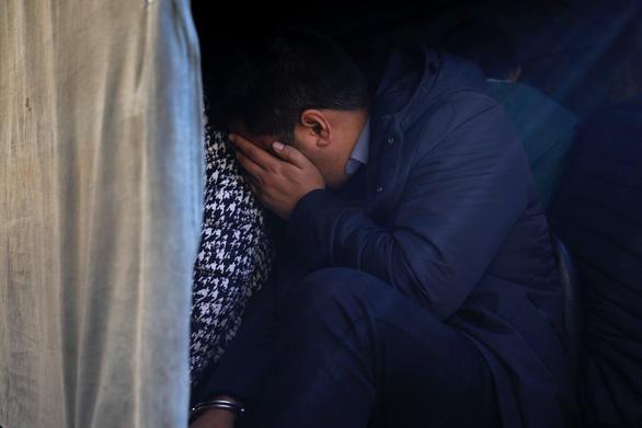 Nepal bắt giữ 122 nghi phạm người Trung Quốc gian lận tài chính - Ảnh 1.