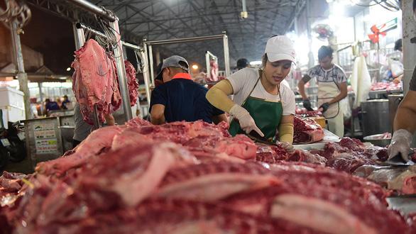 Thịt heo bị đầu cơ thao túng giá, ra quân kiểm tra đồng loạt - Ảnh 1.