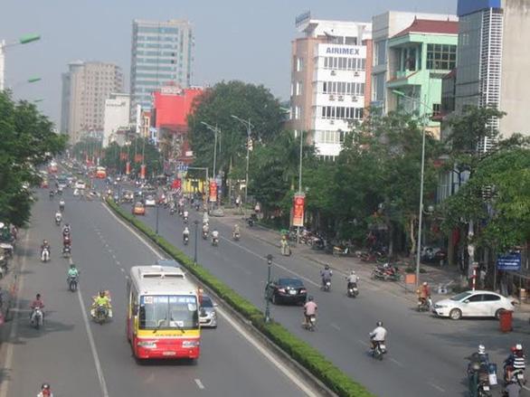Hà Nội phân luồng giao thông để thi công tuyến đường 40m - Ảnh 1.