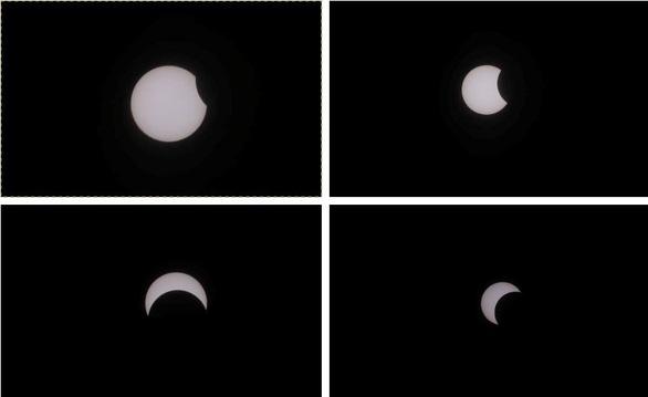 Ngắm nhật thực cuối cùng của năm ở TP.HCM - Ảnh 1.
