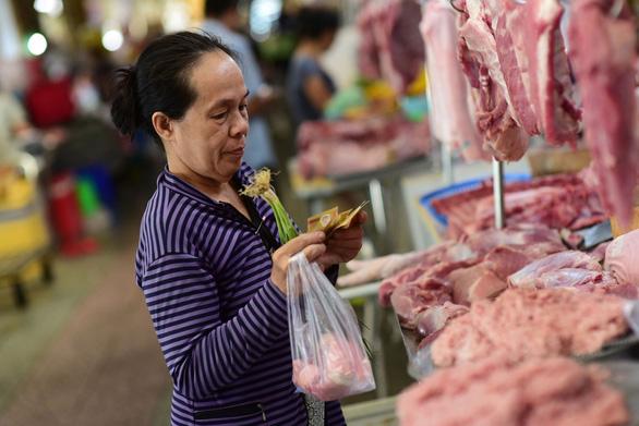 Đề xuất giữ giá bình ổn thịt heo cận tết thấp hơn 10% so với giá thị trường - Ảnh 1.