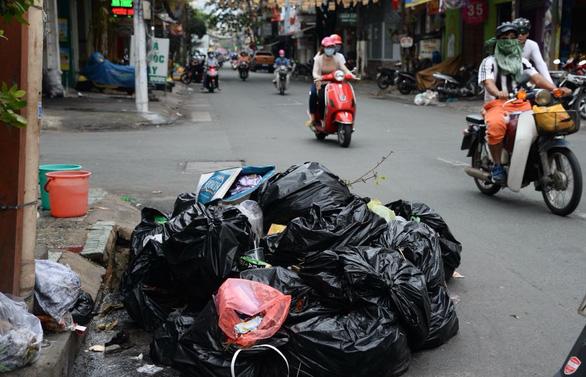 WWF: 30% hộ gia đình ở Việt Nam đã phân loại rác, hộ kinh doanh làm ngơ - Ảnh 1.