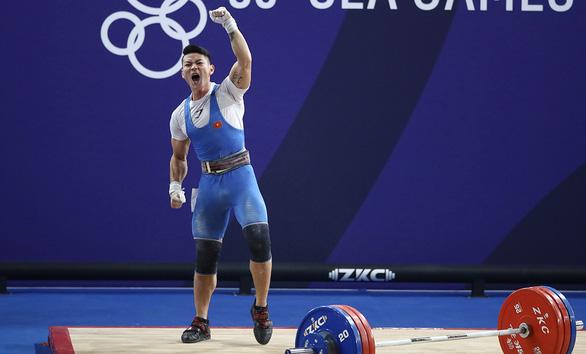 Lực sĩ Thạch Kim Tuấn và tấm huy chương bạc SEA Games đầy cảm xúc - Ảnh 1.