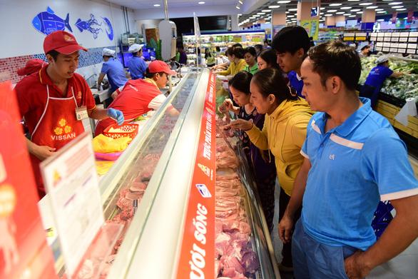 Bớt lo thịt heo khi mua sắm tại siêu thị - Ảnh 1.