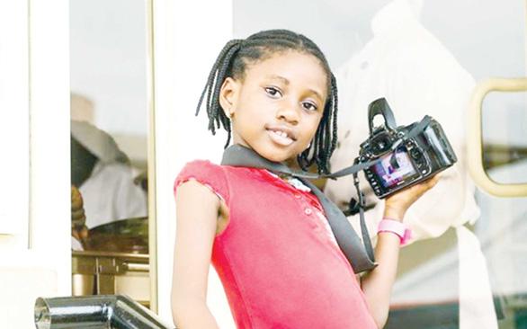 Nhiếp ảnh gia chuyên nghiệp 8 tuổi - Ảnh 1.