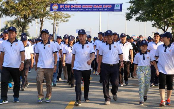 Hơn 1.500 vận động viên đi bộ đồng hành ủng hộ quỹ Vì người nghèo - Ảnh 5.
