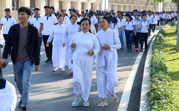 Hơn 1.500 vận động viên đi bộ đồng hành ủng hộ quỹ Vì người nghèo - Ảnh 7.