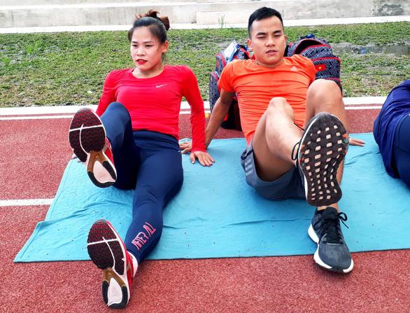 Con được 6 tháng, mẹ bỉm sữa tập luyện giảm 32kg để thi đấu SEA Games - Ảnh 1.