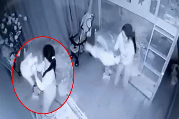 Tạm giữ người phụ nữ giúp việc bị tố dốc ngược bé gái 1 tuổi - Ảnh 1.
