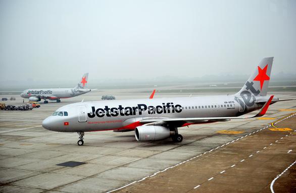 Máy bay đi TP.HCM quay đầu cấp cứu nữ hành khách... uống nhiều cà phê - Ảnh 1.