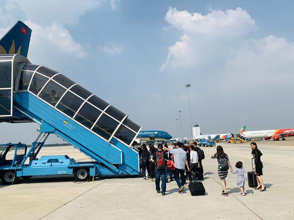 Vietnam Airlines tung ra loại vé không hành lý ký gửi - Ảnh 1.
