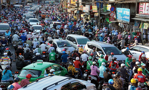 Năm 2030, hạn chế xe máy ở 4 quận và 2 khu đô thị bậc nhất ở TP.HCM? - Ảnh 1.